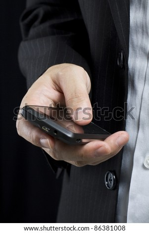 Business man using smart cell phone