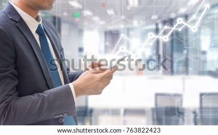 Business man using smart phone on futuristic technology connection shape over the motion interior space background with graph rise up.Concept of business people use technology. #763822423