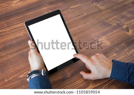 Business man using tablet computer. Tablet vertical screen mockup.