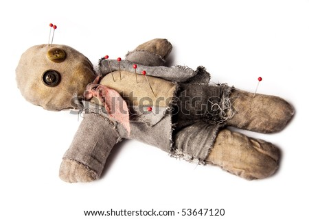 business man voodoo doll with needles laying on white - stock photo