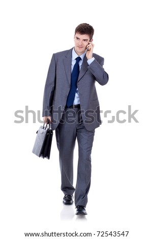 Business man Walking forward while talking on the phone over white - stock photo