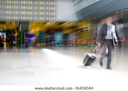 Business man walking in the Airport Terminal