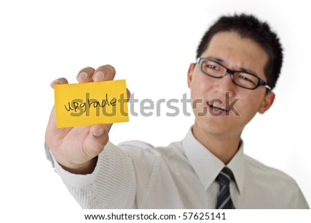 Business man want to upgrade and holding yellow card on white background.