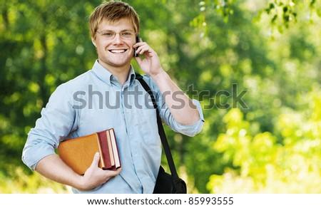 business man wearing glasses bag shoulder talking phone books