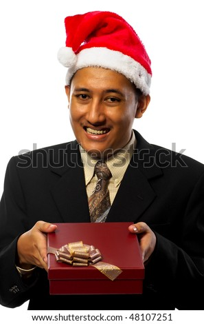 Business man wearing santa's hat is giving a gift isolated on white background