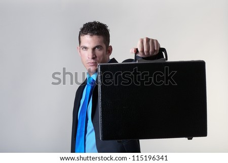 business man with a briefcase shot on a white back ground