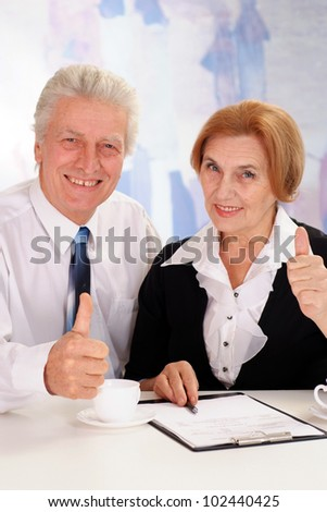 business man with a business woman on a light