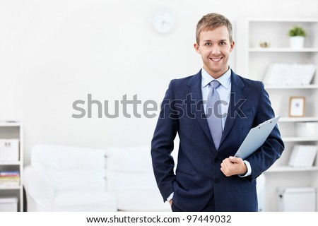 Business man with a clipboard at home