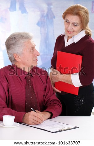 business man with a lady on a light background