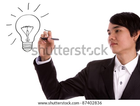 Business man with a pen drawing light bulb