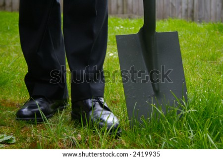 Business man with a spade