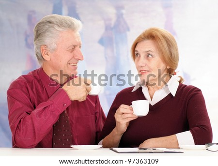 business man with a woman drinking coffee on a background