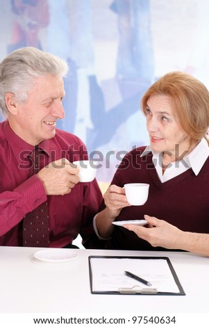business man with a woman drinking coffee on a isolate
