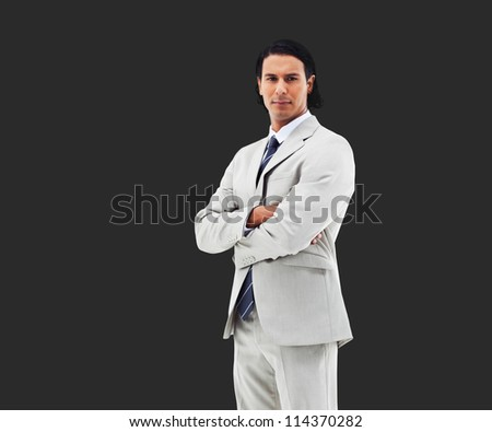 Business man with arms folded on black background