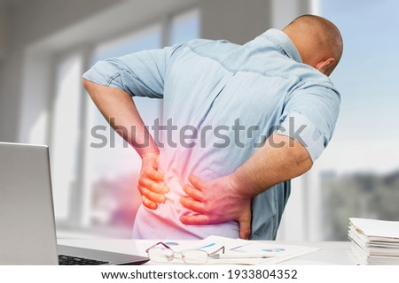 Business man with back pain in office ストックフォト ©
