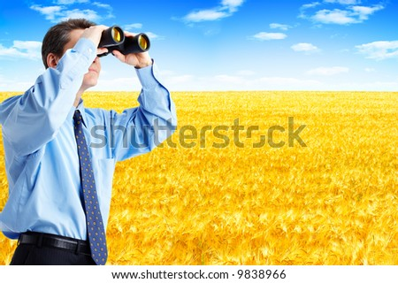 business man  with binoculars looking to the future - stock photo