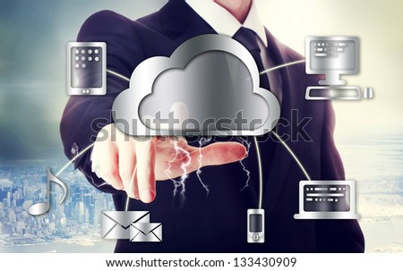 Business man with cloud computing theme with big city backdrop