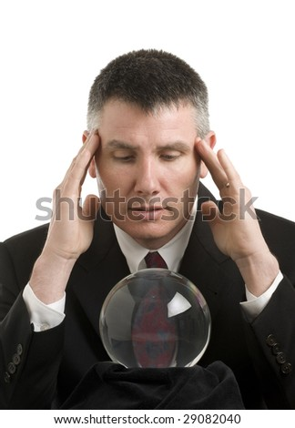 Business man with crystal ball looks for guidance