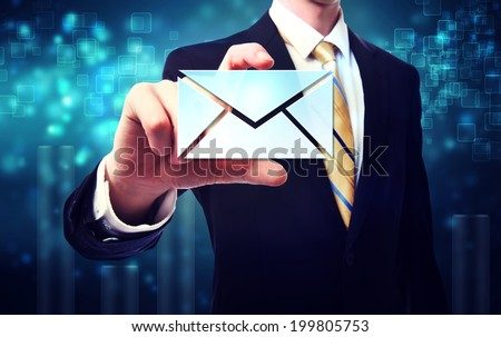 Business man with email envelopes on blue technology background