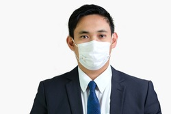 Business man with face mask for corona COVID protection. Employee wearing business corporate suit attire for office on protective mask for isolation