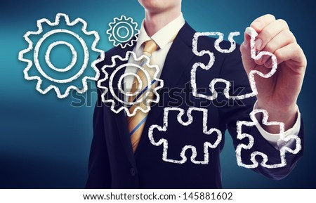 Business Man with Gears - Ideas and Puzzle Pieces - Strategy