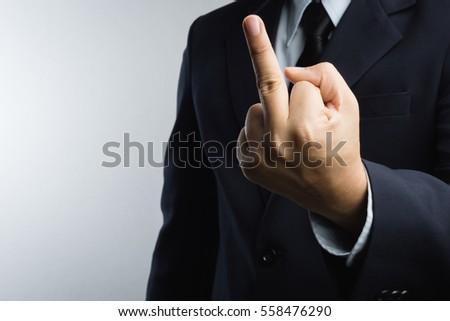 Business man with hand gesture represent bad word as fuck you on white background #558476290