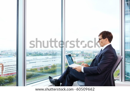 Business man with laptop in the office