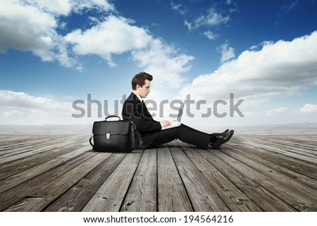 business man with laptop on wooden floor #194564216