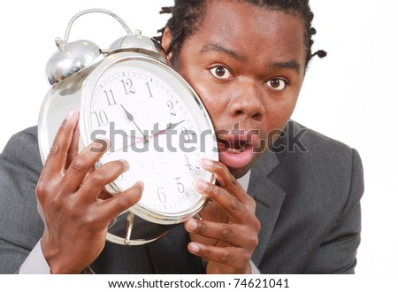 Business man with large alarm clock