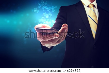 Business man with mobile phone and technology background