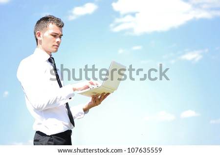Business man with notebook on sky