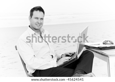 Business man with office on the beach