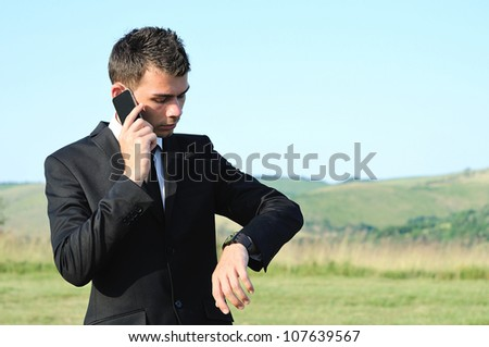 Business man with phone in nature