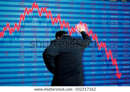 Business man with stock market disaster