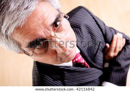 Business man with suit and tie, looking at the camera. High view