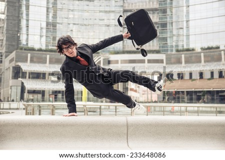 business man with suitcase jumping over urban obstacles man with elegant suit running at work business concepts business life office