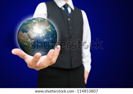 Business man with the digital globe ball on his hand, Elements of this image furnished by NASA