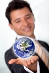 Business man with the world in his hands isolated over a white background