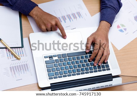 Business man work at office with laptop and report finance , sales summary document on table Stock fotó ©