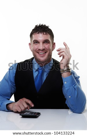business man working at his desk adding up doing sums