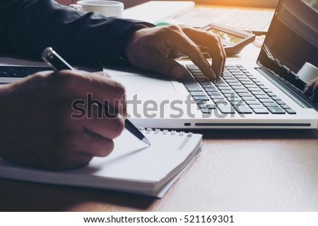 Business man working at office with laptop and documents on his desk