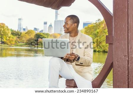 stock-photo-business-man-working-dressing-in-cream-blazer-collarless-sweater-white-pants-wearing-a-234890167.jpg