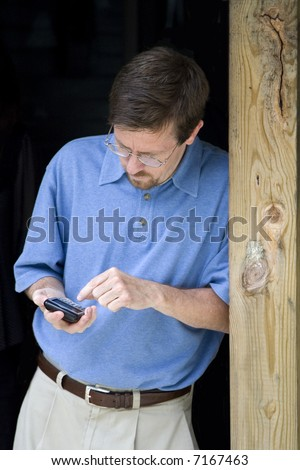 Business Man Working on Blackberry Phone