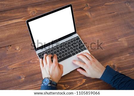 Business man working on laptop computer. Laptop screen mockup.