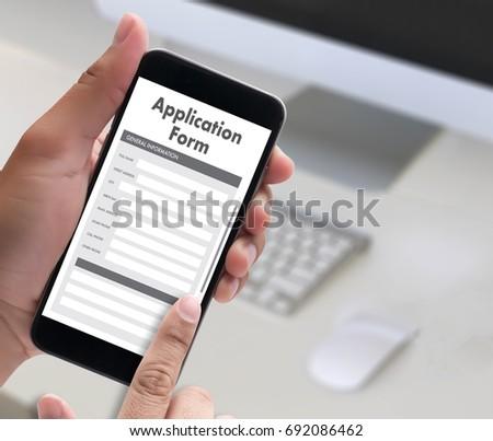 business man working on laptop computer use Online Web Job Application Form moniter #692086462