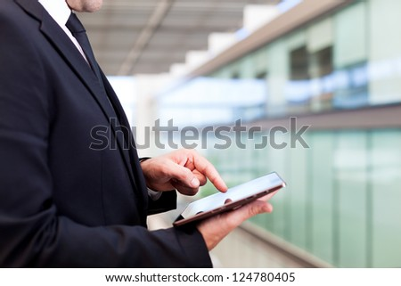 Business man working with a digital tablet at modern office