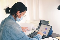 business man working with documents and digital tablet on home office table make startup business report after coronavirus outbreak has impacted businesses