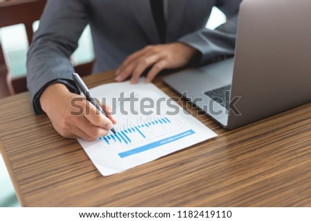 business man working with documents and laptop #1182419110