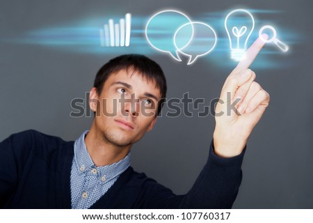 Business man working with his modern computer and virtual interface. Merge of technologies concept
