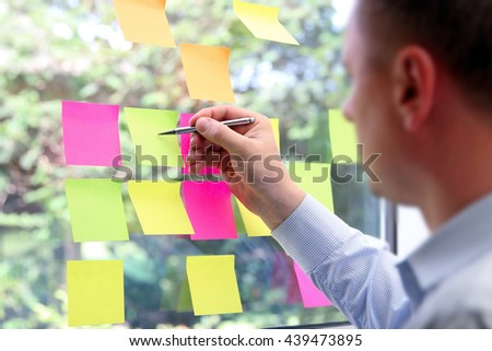 business man  working  with  stickers in office #439473895